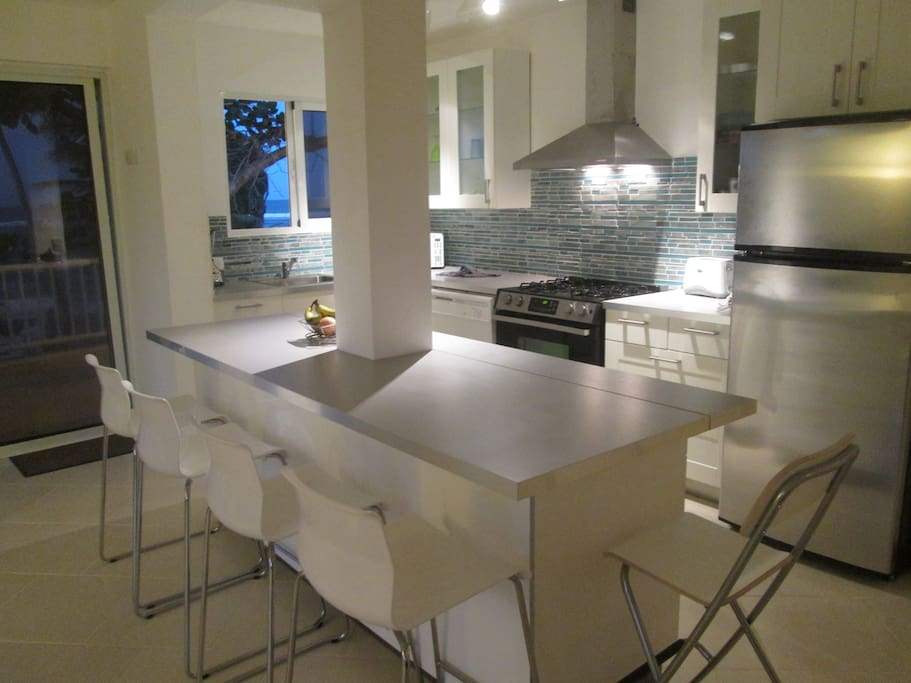 New kitchen with all new stainless steel appliances and dishwasher
