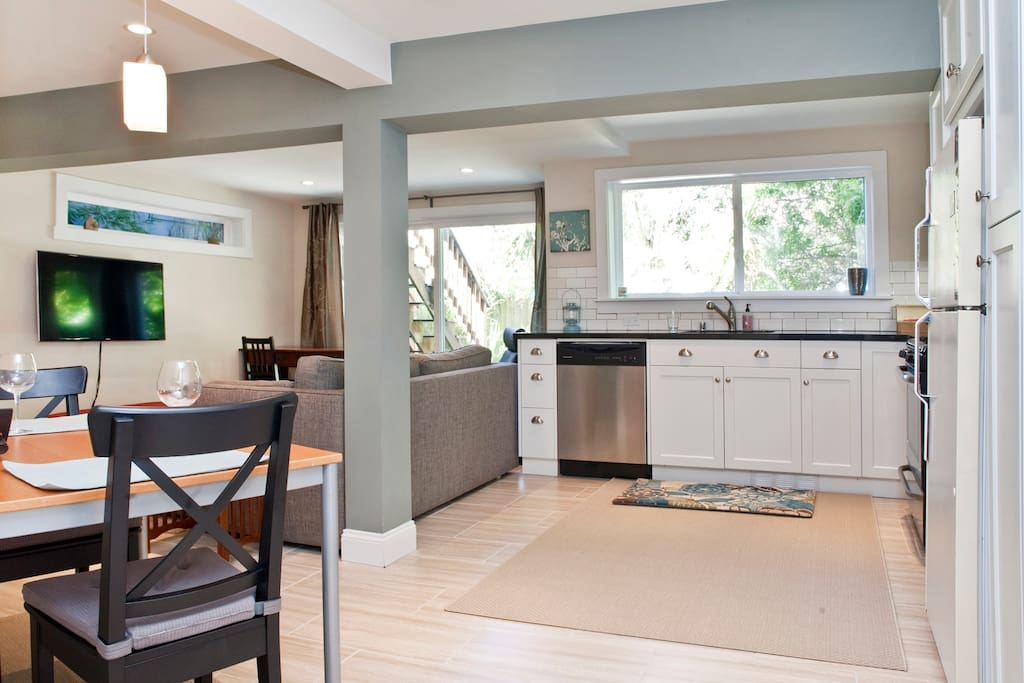 Fully-stocked kitchen includes custom cabinets, granite counter top, range, dishwasher, and Keurig coffee machine with free coffee.