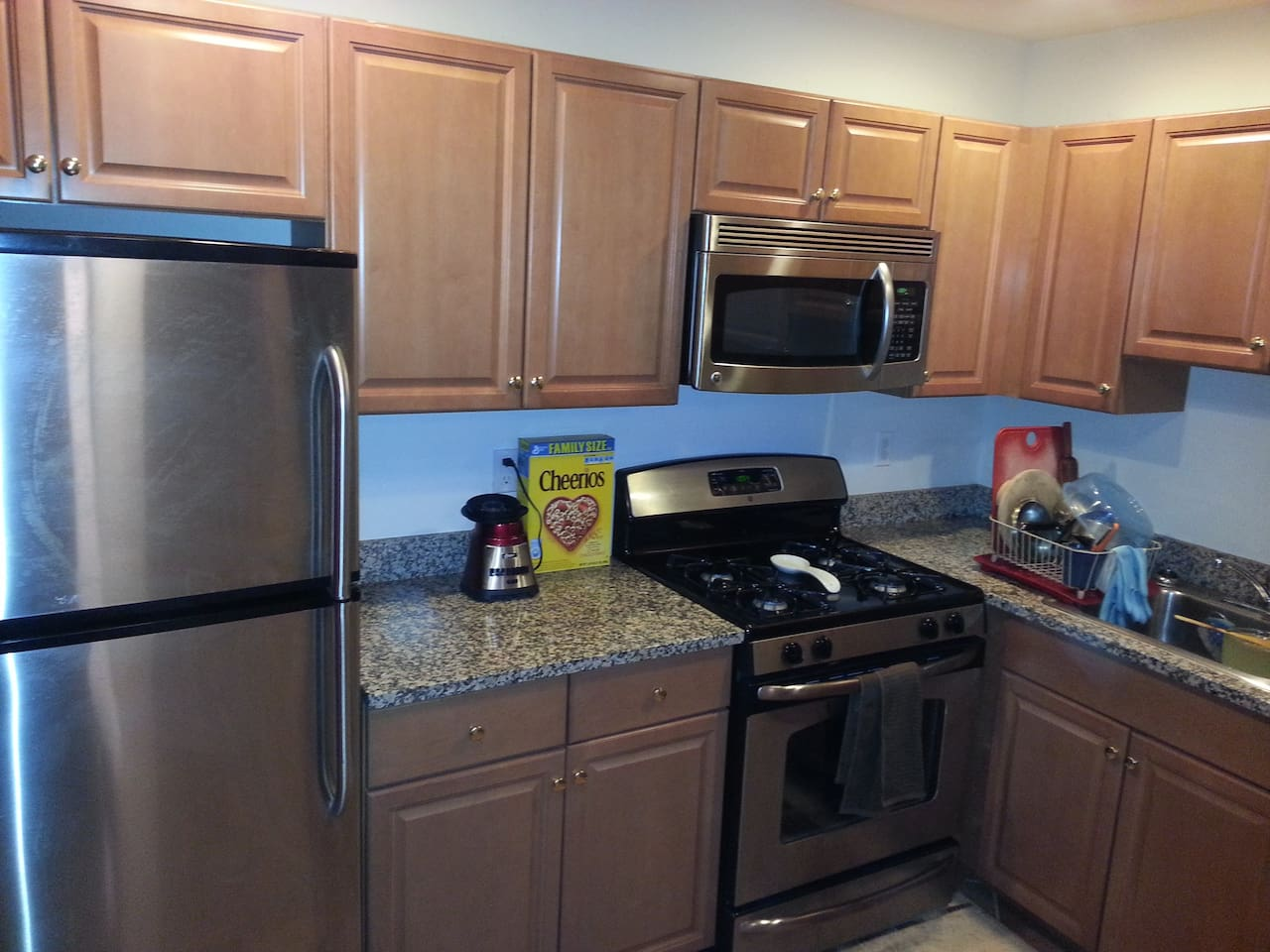 Kitchen with Stainless Appliances and Granite Counter-top