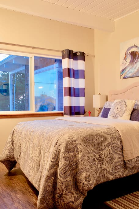 Our main bedroom with an ocean view. Dream peacefully with the sound of the waves.