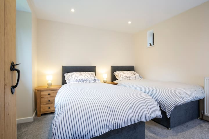 The master bedroom with two single beds