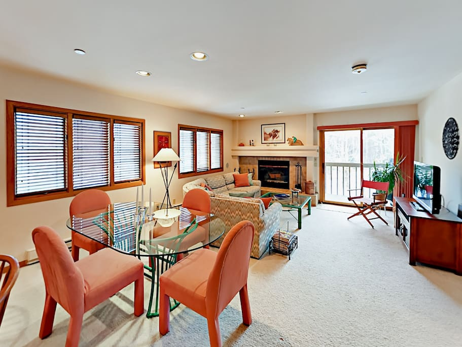 Western décor and a wood-burning fireplace add warm ambience in the living room.