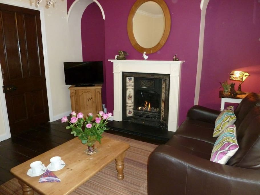 Walkers Rest lounge with cosy gas fire, Lakes Cottage Holidays