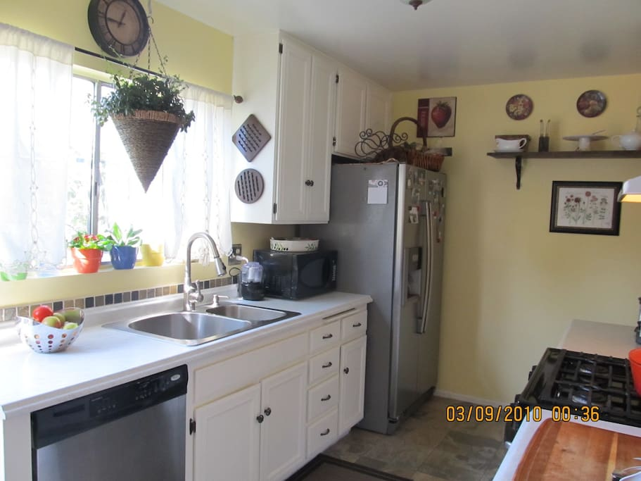 sunny, fully equiped kitchen with fresh herbs garden