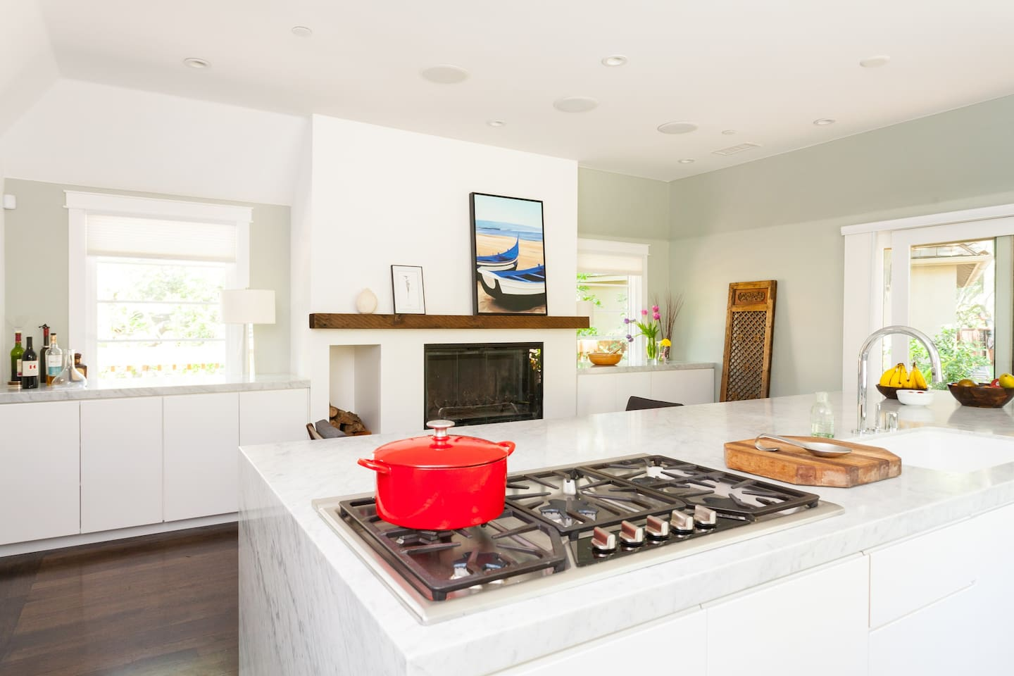Kitchen the size of a 2 car garage and with a fireplace in it.