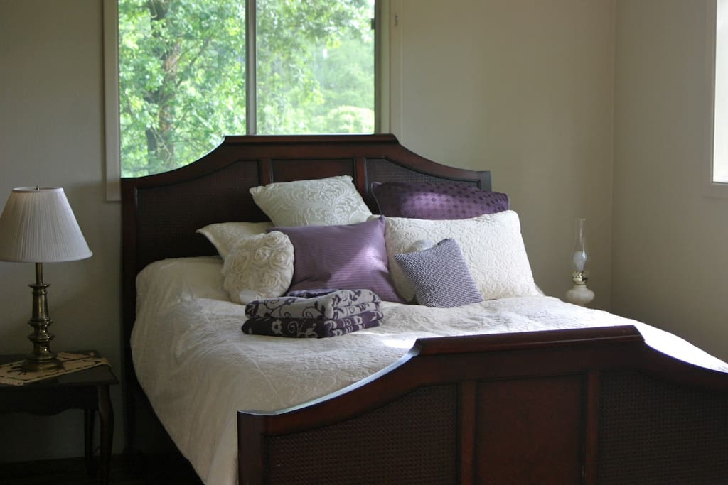 comfy queen size bed with down comforter.