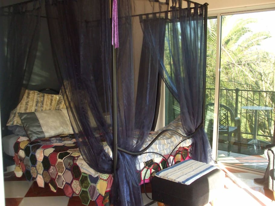 Romantic 4 poster bed, and wrap-around balcony with views