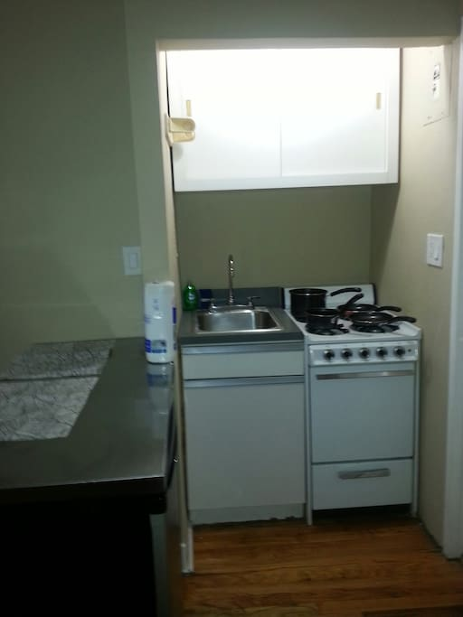 Kitchenette has Refrigerator, Stove, Utensils, Pots, Pans,microwave, coffee maker.