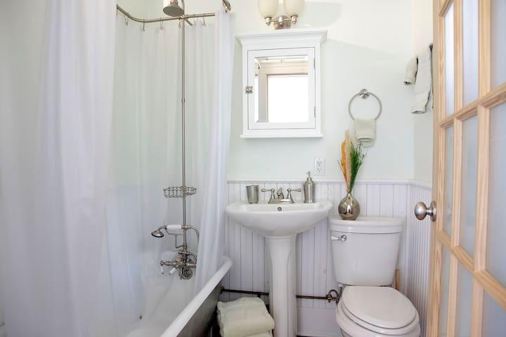 Bath with pedestal sink, clawfoot tub and shower, tiolet
