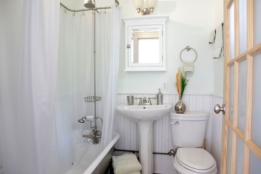Bath with pedestal sink, clawfoot tub and shower, tiolet