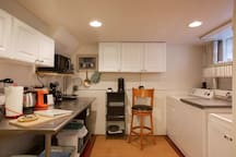 Here's a good view of the kitchenette.  The cupboards have cooking pots and pans, as well as plates, bowls, glasses and cups.   The fridge is below the utility shelf.