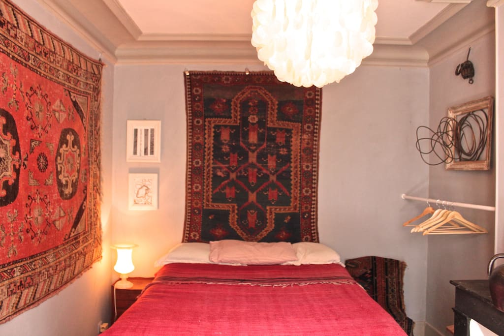 there is a nice collection of rare antique caucasian and uzbek rugs, giving a cozy feeling to the room