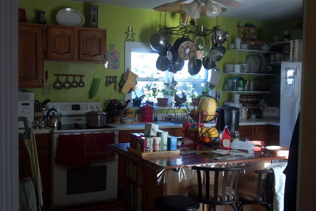 Our kitchen is farm-home style: lived in and spacious enough for multiple 'chefs'
