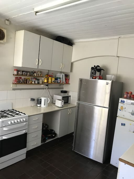 Shred kitchen with fridges, gas stove top, gas oven and all plates/cooking equipment