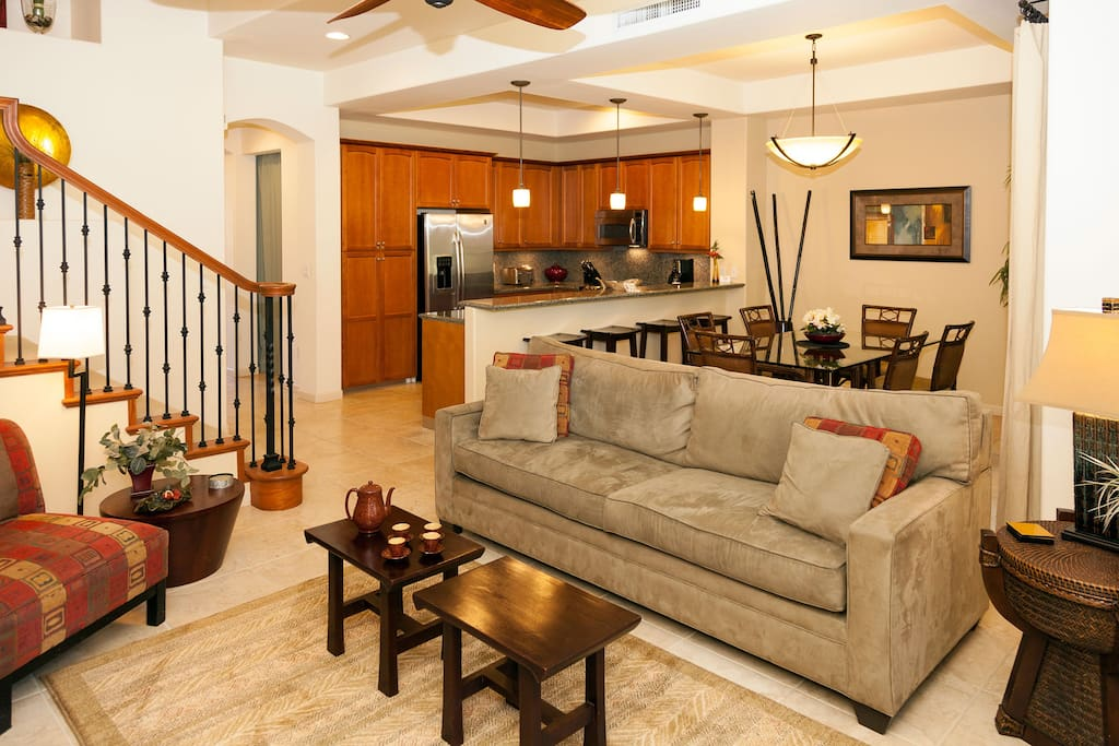The main floor has an ideal layout with easy flow from the kitchen, Lanai, and dining areas to the living room.