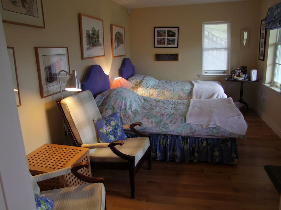 Spacious and comfortable twin room with direct access to outside seating area