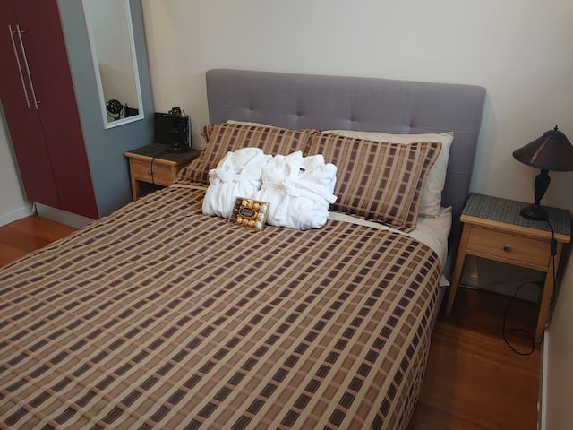 Luxury bedding, contour foam pillows, fluffy white bathrobes. Blackout blinds for restful sleep.
