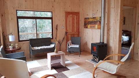 Tierra de Peumos Cabins, beautiful newly built cabin, located in an ideal space to connect with nature and recharge energy. Located in the magical Rari Valley, on a land of more than 30ha with access to the river and hill.