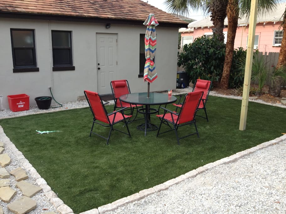 New backyard area with Ultra Lush 2 astro turf and sun sails.