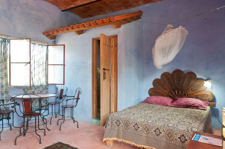 Bed and sitting area, Casita Teatro, bedroom one, on the left-side