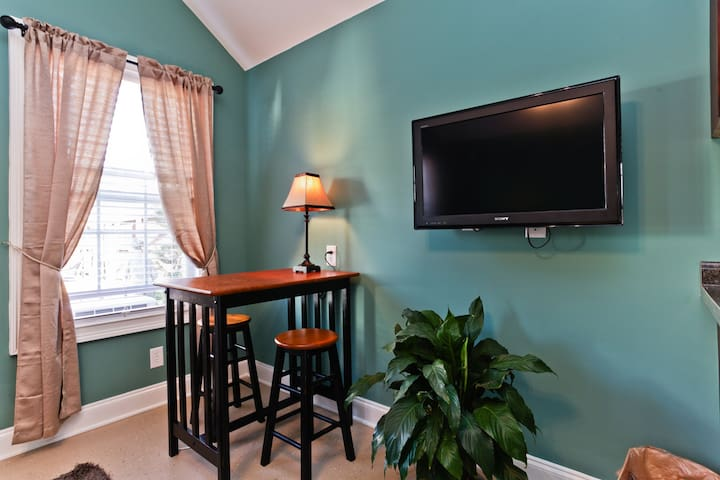 Convenient table for dinner or to get some work done!   Sony Flat panel TV with cable for  your enjoyment!