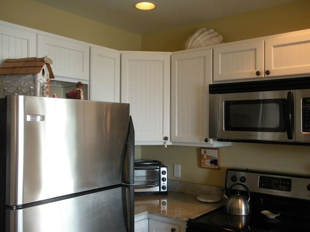 Fully equipped kitchen with all cooking supplies.