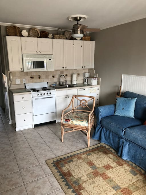 Kitchen with stove, dishwasher, refrigerator and microwave
