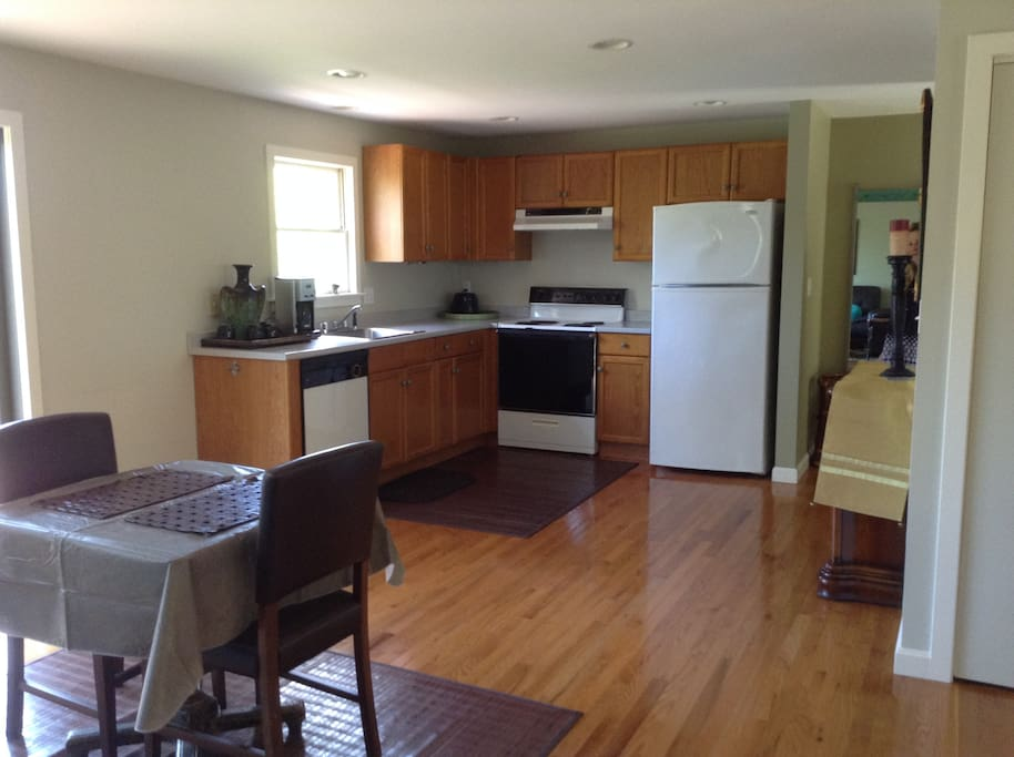 kitchen with all the amenities: full electric range and oven, refrigerator, dish washer.