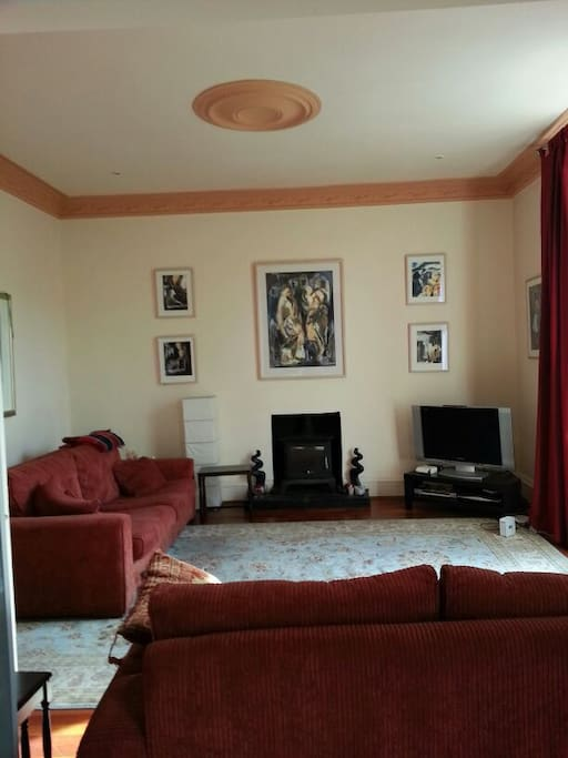 Large living room with adjoining dining room. Full use of Sky TV package.