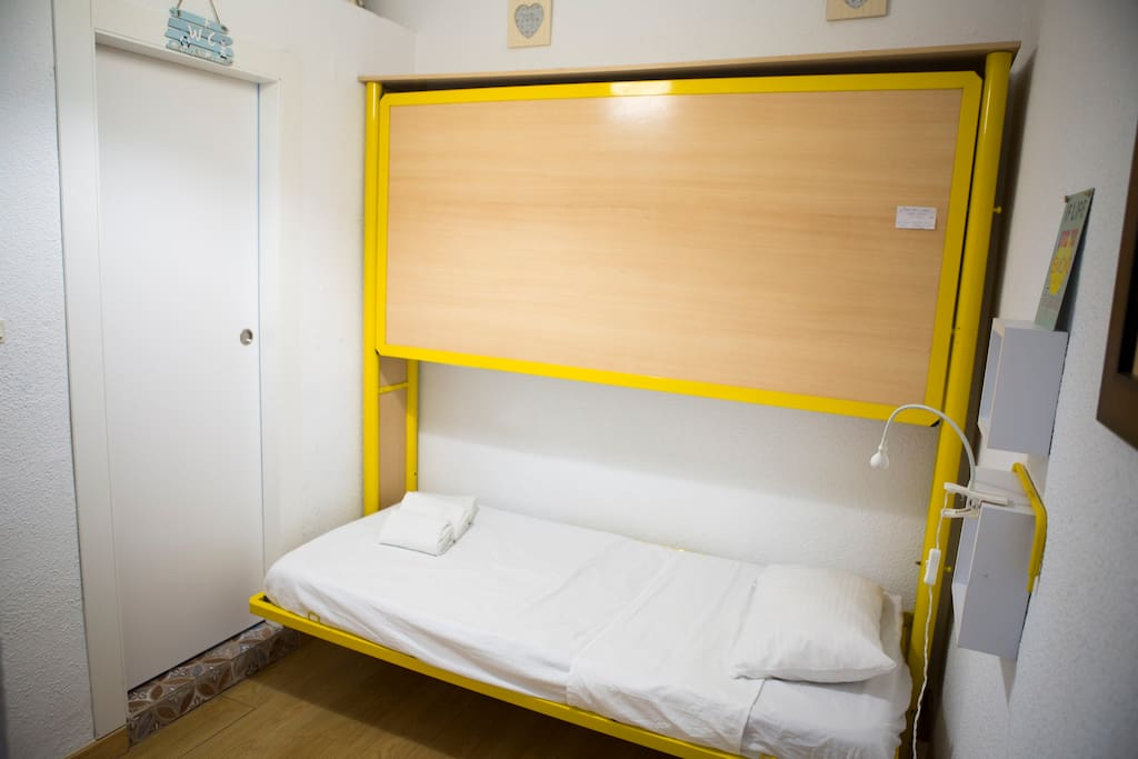You can open one or two. The beds are in a room   Toilet has door without lock. This studio is for Family or good friends. The room doesn't have door with the living room where is the couch.
