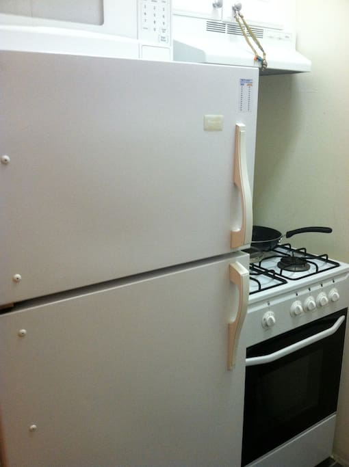Kitchen includes fridge, stove, microwave, cooking utensils, plates and silverware will be left for use.
