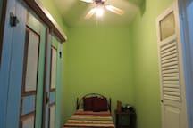 Cupboard, single bed, ventilator.