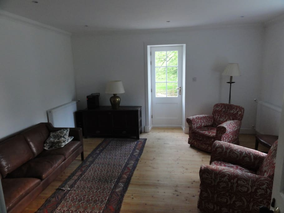 Living room furnished with classic and antique furniture with Hi Fi (but no TV).