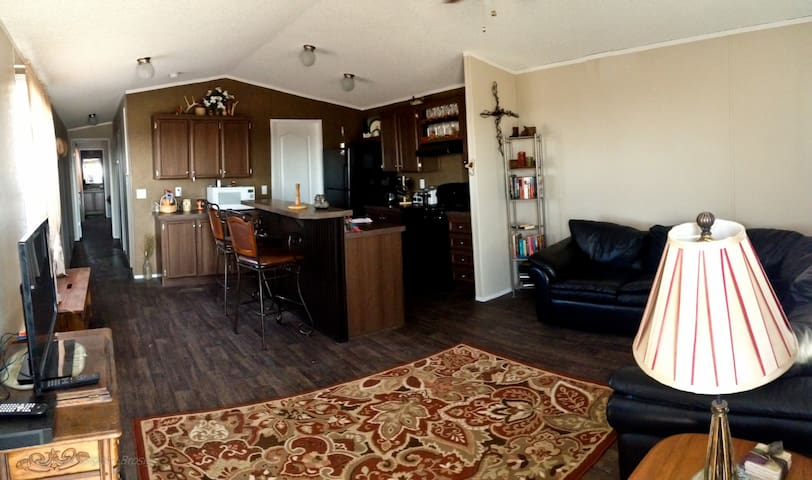 Large living space adjoins to fully equipped kitchen.  Just bring food or arrange for us to set you up for your visit.  BBQ pit outside.