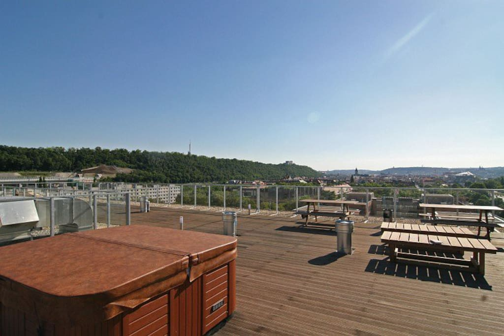 Spacious rooftop terrace provides unique views of Prague panorama