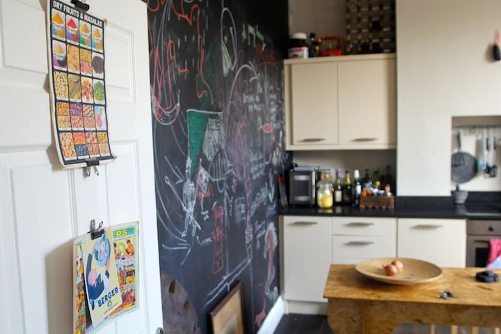 view into kitchen with Black Chalkboard paint wall