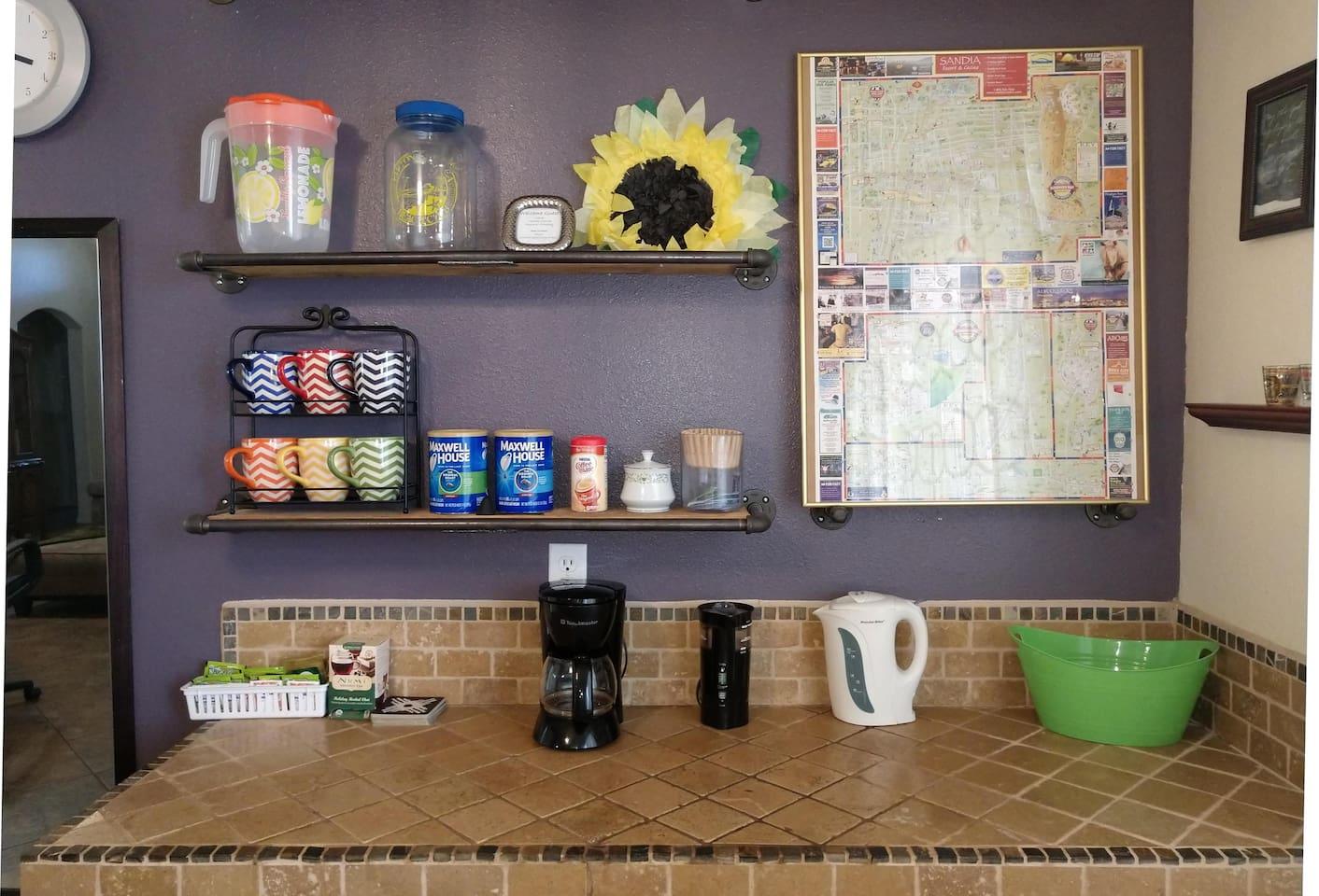 Coffee Bar with coffee maker, electric teapot.  Coffee, tea, sweetener, and creamer provided.
