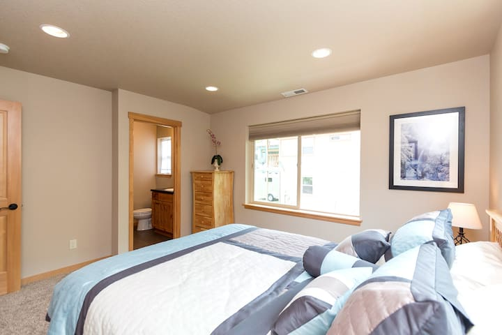 Guest bedroom with queen bed and attached full bath
