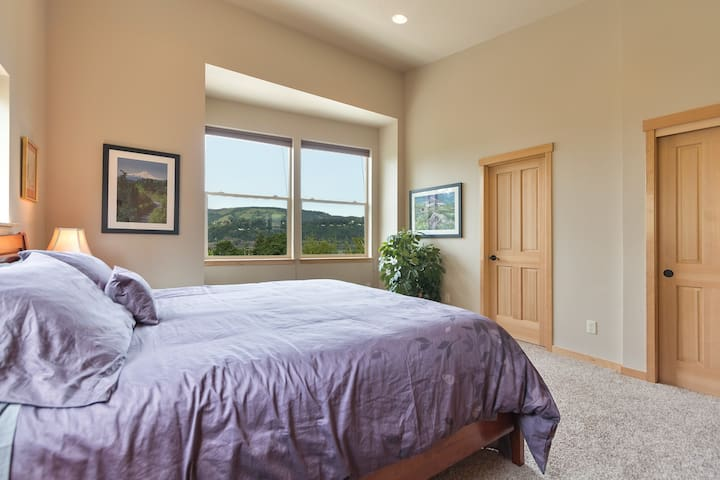 Master Bedroom with King sized bed, attached full bath, vaulted ceilings and gorge views