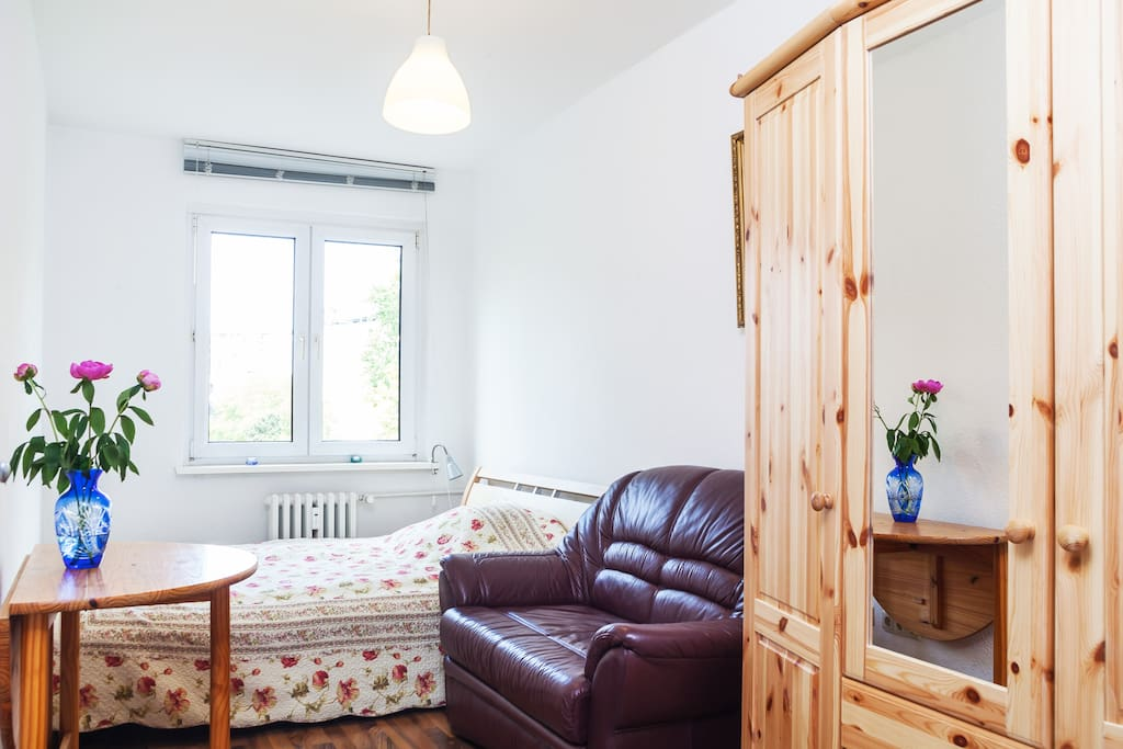 First bedroom with a 3-door wooden wardrobe as your storage space.