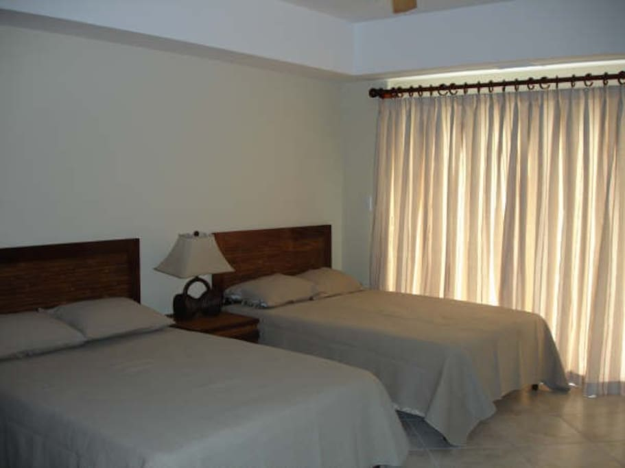 Double beds and an ensuite bathroom and ocean view balcony.