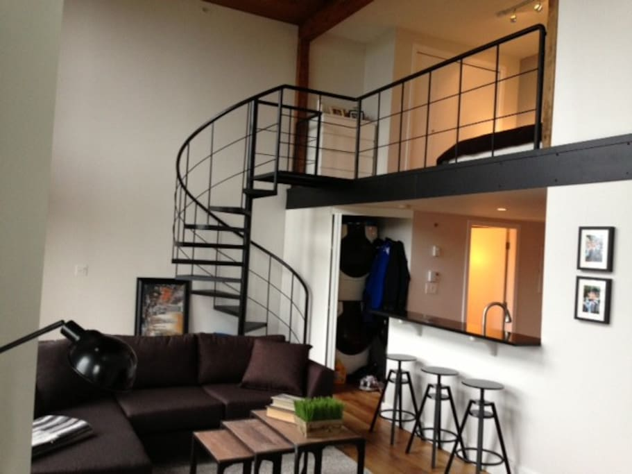 Breakfast bar and spiral staircase access to loft bedroom.  Convenient washer and dryer in unit.