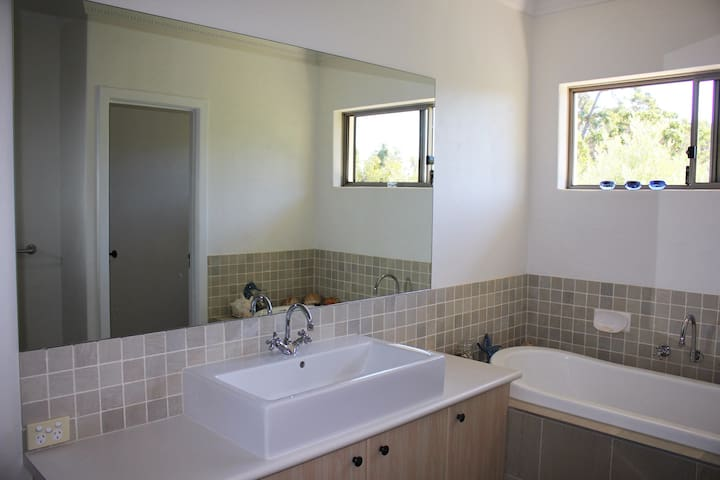 Bathroom with separate toilet and deep bath