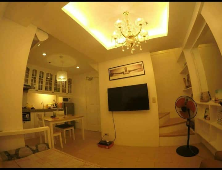 Rustic Style Bi-level unit AC & TV on both floors.