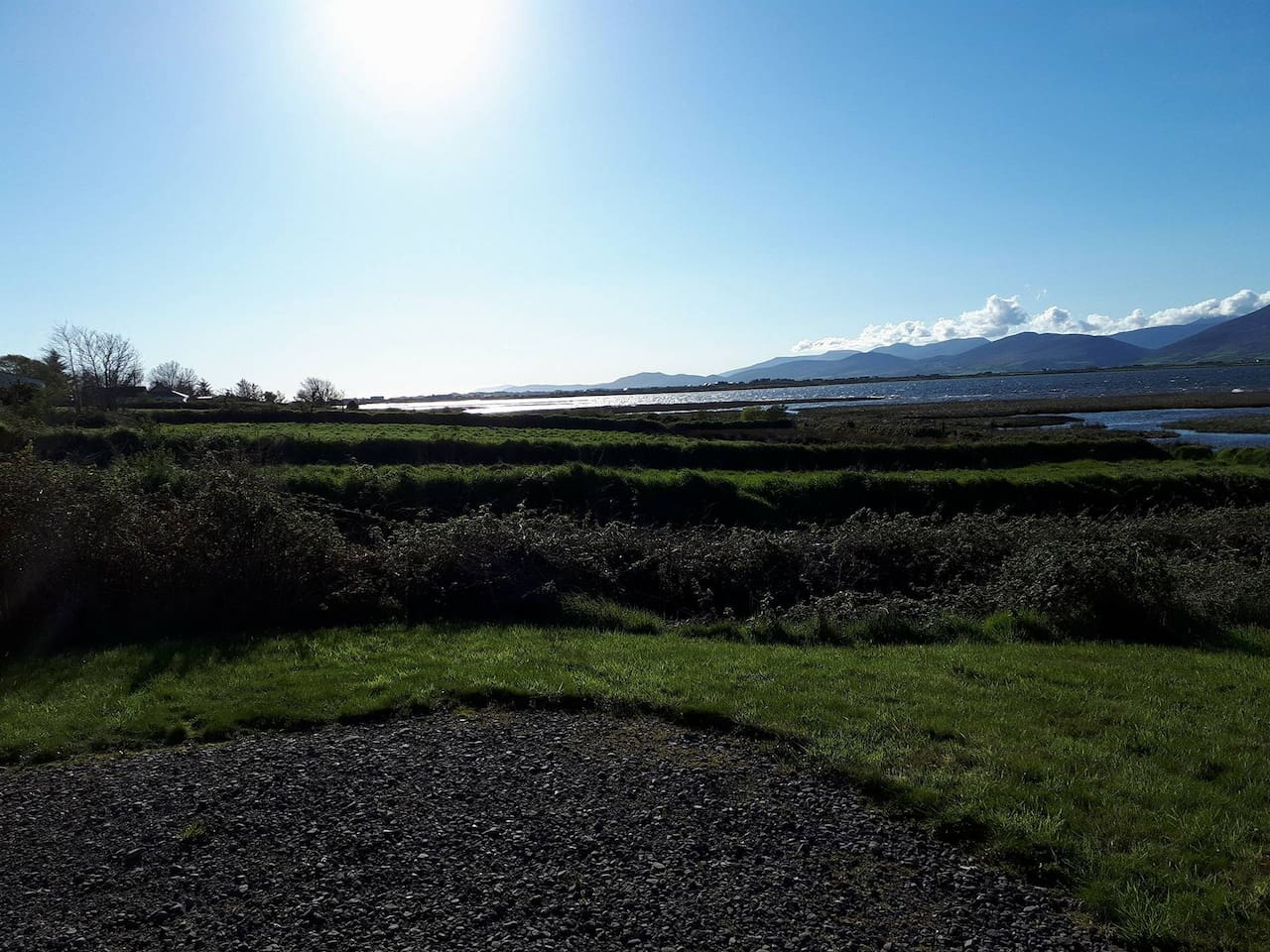 Back garden with view of sea and the mountains of Dingle peninsula