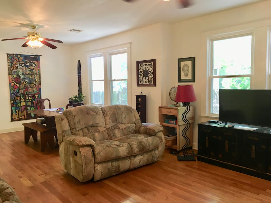 The living room and dining room are combined. We provide our guests with hi-speed Wifi (the signal is strongest in this room of the house) and Directv for cable channels. Please note that during heavy rainstorms signals may be disrupted. There are also a few board games for you to enjoy.