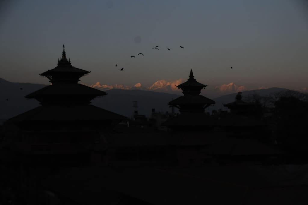 Evening panoramic view of 'Patan Durbar Square' and mountains from our terrace.