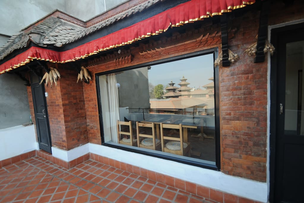 Terrace in front of our breakfast room on the third floor of the guest house. Reflection shows the 'Patan Durbar Square'.