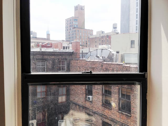 Photo facing south: Freedom Tower, Bowery Hotel, etc.