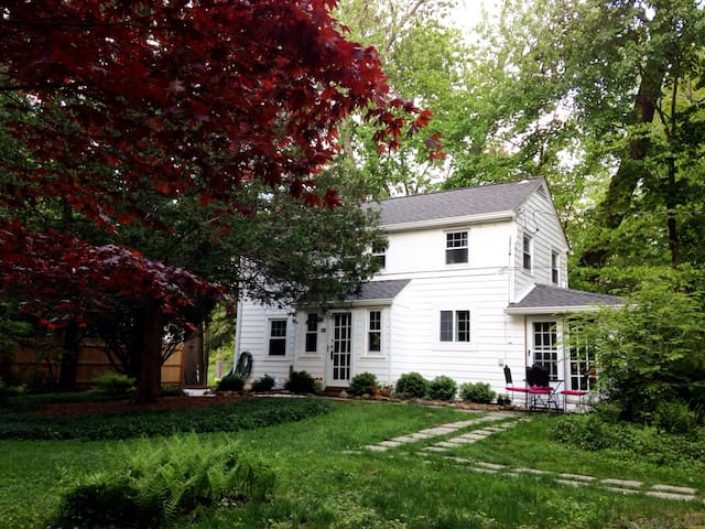 The Sugar Shack is a cozy, storybook clapboard cottage from the 1920's. Set back from a quiet, side street, it is tucked back into the woods affording peace and tranquility.